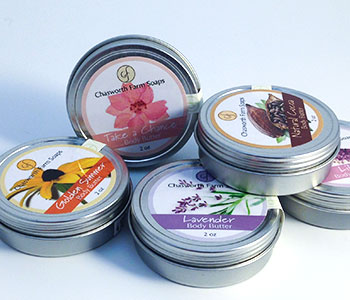 Cream metal container with packaging labels