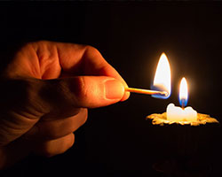 Hand-light-candle-match