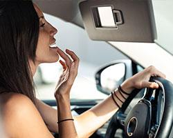 woman-in-car-lip-balm